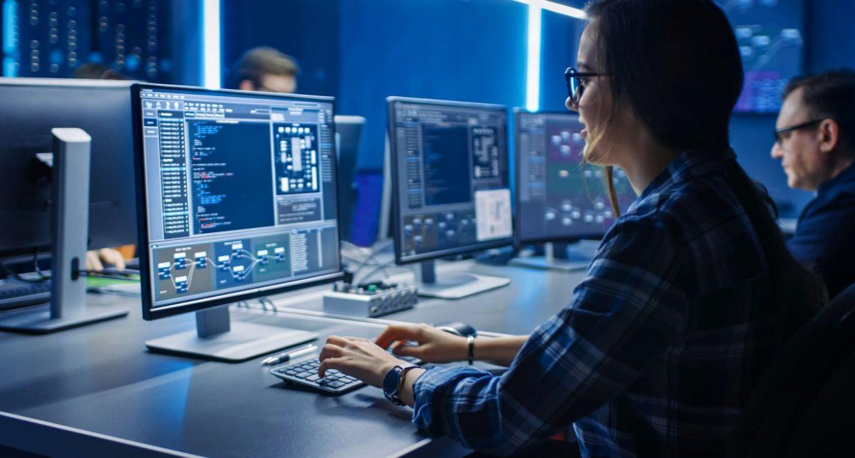 programmer at a computer in an open plan office